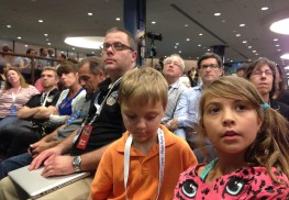 Matt Hill, with his children Sam and Sarah, waiting to hear news of New Horizons NASA program. Courtesy Matt Hill