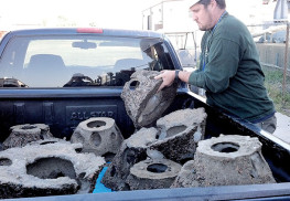 Keven Canning with NY/NJ Baykeeper hauls reef balls to be used as part of the oyster restoration project at Naval Weapons Station Earle, Leonardo.