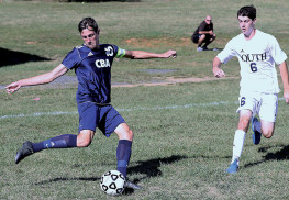 Nicholas Meyer (10) of CBA gets ready to kick the ball as Nick Mihoulides (6) of Middletown South closes in. Meyer scored a goal for the Colts. Photo by Sean Simmons