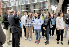 Red Bank Mayor Pat Menna addresses a group of graduate students from the People's Republic of China on a tour of Red Bank. Photo: Madelynne Kislovsky