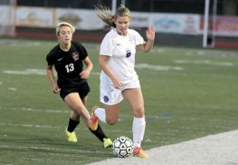 Emma Gill (6) of Rumson-Fair Haven dribbles past Carissa Eckel (13) of Jackson Memorial. Photo: Sean Simmons