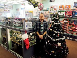 Alan Placer, owner of Hobbymasters in Red Bank, is using coupons, mailings and fascinating in-house working train displays to attract in local customers for the holiday shopping season. Photo: Madelynne Kislovsky