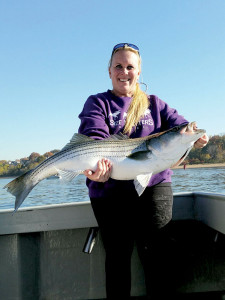 Nicole Lenar with a nice striper! Photo: Chris Bauer