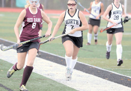 Christine Gebhardt (19) of Middletown North slips past Tori Sullivan (19) of RBR. Photo: Sean Simmons