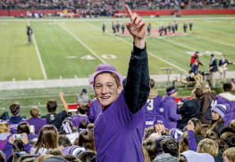 "Rumson-Fair Haven Regional fan Vincent Mazzeo gives the ""Number One"" sign in the student section, at halftime. The game was held at Rutgers on Saturday night. B51 Photography: Mark Brown"