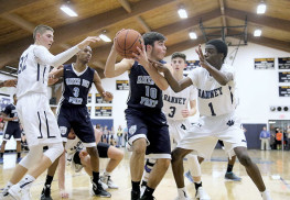 Shane Mastro (10) of Mater Dei Prep gets swarmed by Ranney defenders Bryan Antoine (1), Alex Klatsky (3) and Chris Autino (32). The Seraphs handed the Panthers their first loss of the season and gained sole possession of first place in the B Central Division. Photo: Sean Simmons