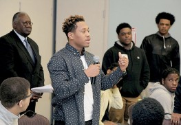 Neptune High School senior Leclerson Isimeus addresses participants at the Minority Male Initiative Conference at Brookdale Community College.
