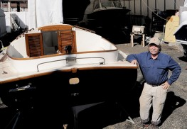"Carriage House Marina owner Lance ""Chick"" Cunningham with a recently refinished Sanderling."