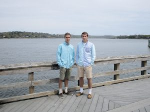 Noah Tucker, left, and Tyler Lubin at the Fair Haven Dock on the Navesink River. They have a plan to keep bacteria out of the river.