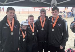RFH rowers who competed at the Long Island Youth Championships from right to left - Nicholas Bermeo, Ryan Kearney, Dawson Epstein, Taylor Glassman (Coxswain), and Edward Osmulski. COURTESY RFH ROWING