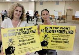 Joanne Formica and Kristin Lunanuova, both with RAGE (Residents Against Giant Electric), came out to a JCP&L public session on June 8, to voice their opposition to the electric company's plan to build a 10-mile additional power line in Monmouth County along NJ Transit commuter train line. Photo: John Burton