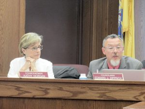 Red Bank Borough Council members Kathy Horgan and Edward Zipprich vote to adopt the 2016 municipal budget at the June 8 council meeting.