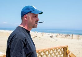 Kyle Worland with an e-cigarette on the boardwalk at Sea Bright Beach.