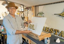 Bob Gamache works on a gold gilded glass project for customer Ralph Lauren.