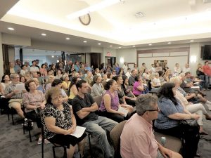 Hazlet and Middletown residents look on during an open-forum portion of the special JCP&L related meeting on June 20.