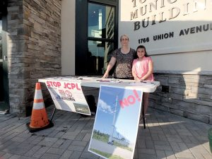 Frances Haies (left) and daughter Sarah next to their information stand outside the Hazlet Township Municipal Building prior to the meeting.