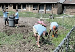 Employees of Goldman Sachs financial services firm volunteered their time last Saturday to help get Red Bank Primary School in shape for the start of the school year.
