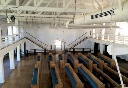 """The truss ceiling system and two fireplaces inside Fort Monmouth's former Dance Hall will be retained in the new design. Photo by Fuller """"Trip"""" Brooks"""