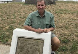 Walter Guenther of the Highlands Historical Society at the memorial stone honoring World War II dead in Veterans Memorial Park in Highlands.