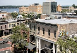 Red Bank's 2015 property assessment revaluation reveals that commercial properties dropped, causing an overall decline in values according to the borough's mayor and CFO. Anthony V. Cosentino