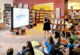 Amy Williams, a coastal ecology extension agent for the New Jersey Sea Grant Consortium, speaks about sharks and rip currents to children at the Oceanic Free Library, Rumson.