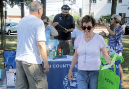 Atlantic Highlands resident Margaret Stockton, 76, and her husband, Richard, 77, left, stop by a Monmouth County Health Department table providing mosquito information in their town's Veterans Memorial Park.