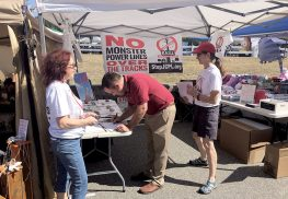 RAGE members collecting petition signatures against MCRP at Hazlet Day Saturday.