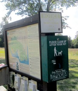 A sign directing the public to dog-waste bags in the Claypit Creek section of Hartshorne Woods Park, Middletown.