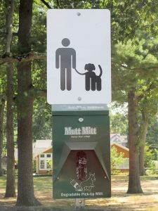 A sign directing the public to dog-waste glove-bags in McCarter Park, Fair Haven.