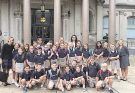 Holy Cross students and teachers gather in front of the Statehouse with Assemblywoman Joann Downey.
