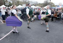 The 16th Annual Highlands Oktoberfest on Oct. 1 will feature dancers in traditional dirndl and lederhosen. COURTESY KEN BRASWEL The participant who holds the beer stein for the longest period of time wins the stein-holding contest. Photo by Ken Braswel