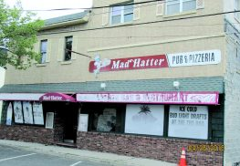 A resident has filed suit in State Superior Court seeking to overturn the local unified Planning and Zoning Board of Adjustment's decision approving the expanded Mad Hatter's rebuilding project. Photo by John Burton