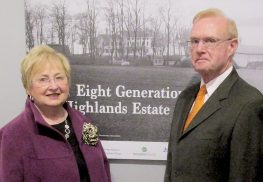 Barbara Carton and her husband, Peter, stand next to a vintage photograph of their circa 1830s house in the Hartshorne Woods area of Middletown. Peter Carton's family has owned the house since the early 1950s, creating a direct ownership to the Hartshorne family. The Hartshornes are a subject of a Monmouth County Historical Association exhibit.