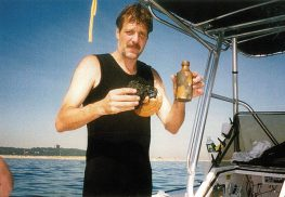Gary Filippone, of Highlands, who led the expedition of the Ship Aurora, stands on his boat with a few artifacts retrieved from the 1824 shipping vessel. Photo courtesy of Gary Filippone.