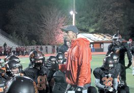 Middletown North head coach Steve Bush addresses his team following the Lions 33-14 win over Woodbridge in the opening round of the North 2 Group 4 state playoffs.