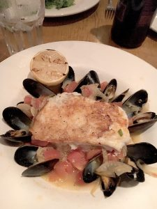 Pan Roasted Grouper is served with steamed PEI mussels. -B. Sacks