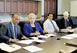 In the room where it happened, a series of pen strokes permanently removed Fort Monmouth from the purview of the U.S. Army. Signing the documents were (left to right): Freeholder Director Thomas Arnone, Freeholder Lillian Burry, Mynor Pivaral representing the Department of Defense, and Noreen Dean Dresser, chief of the Real Estate Division of the U.S. Army Corps of Engineers.