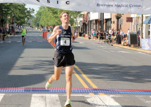 Robert Cavanaugh crosses the finish line of the George Sheen 5K Classic in fifth place on Saturday, June 14.