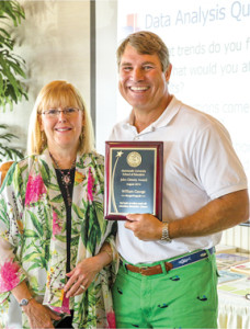 Dr. Lynn Romeo, dean of the Monmouth University School of Education, with William George, Middletown Township superintendent of schools, who is the university's first John Dewey Award recipient. Photo Courtesy of Monmouth University