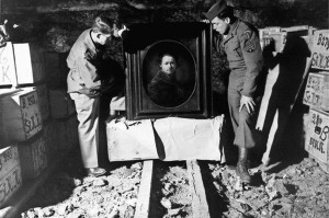 Harry Ettlinger, right, wearing a cap, displays a Rembrandt self-portrait, circa. 1645. It was one of the great works of art Ettlinger and other Allied forces recovered and returned to rightful owners during and immediately after World War II.