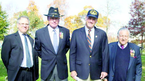 Participating in Rumson's Veterans Day ceremony are, from left, Rabbi Jeff Sultar of Congregation B'nai Israel, and borough residents Daniel J. Edwards, Mike Lilley and Elliot Vernon. Photo by Marnie Doherty Photography