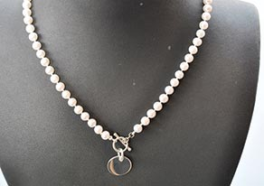 Pearl Necklace with Engraveable Silver Disc The Golden Goose, Rumson. Phone: 732-530-9696. Website: www.goldengoosejewelers.com