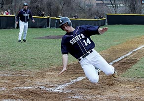 Austin Markmann (14) of Middletown South slides safely into home plate during last Friday's game against crosstown rival Middletown North. Photo by Sean Simmons