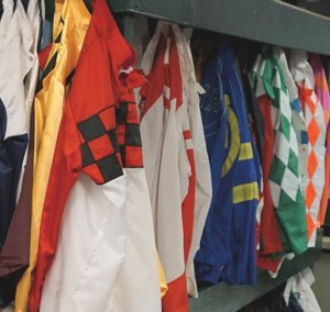 Colorful silks are worn by jockeys to identify a thoroughbred's owner. Photo: Art Petrosemolo