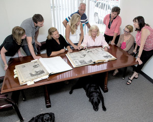 TRT staff members take a look back at the first editions of the Two River Times on Sept. 2, 2015. Photo: TIna Colella