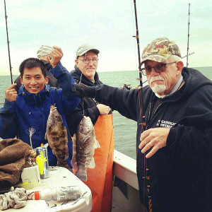 From left to right: Will Hoffman, Dennis McGinnis, and Ron McClelland enjoying blackfishing on the Long Shot. Photo courtesy Chris Bauer