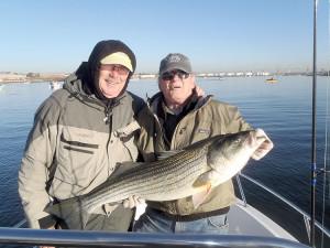Joe and Leon with a big striped bass.