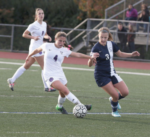 Sofi Giglio (4) of Rumson-Fair Haven battles Maggie Wysocki (3) of Arthur L. Johnson for the ball. Giglio scored a first half goal to give the Lady Bulldogs a 1-0 lead. Photo: Sean Simmons