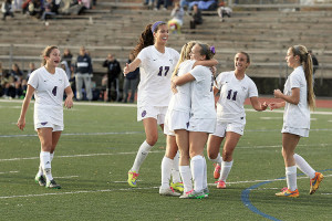 Members of the RFH girls soccer team congratulate Grace Forsyth (2) after scoring a goal in the second half for the Lady Bulldogs to seal a 2-0 win over the Crusaders in the NJSIAA CJ Group 2 semifinals on Monday. Photo: Sean Simmons