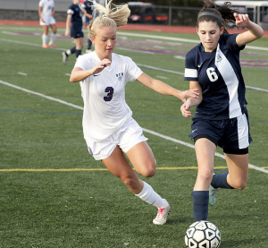 Jacqueline Littleson (3) of RFH fights Jessica Gannon (6) of Arthur L. Johnson for the ball. Littleson had an assist for the Lady Bulldogs. Photo: Sean Simmons